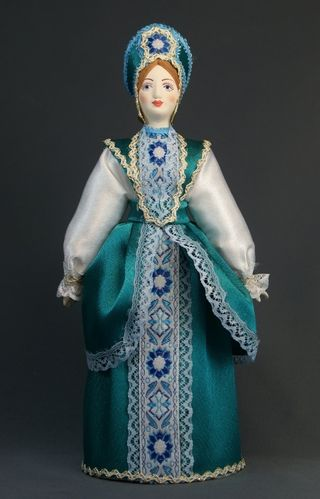 Doll gift porcelain. Kursk lips. Russia. Maiden costume. The 2nd half of the 19th century.