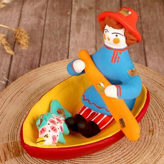 Dymkovo clay toy Man in the boat