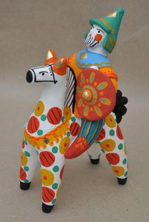 Dymkovo clay toys Bogatyr on the horse