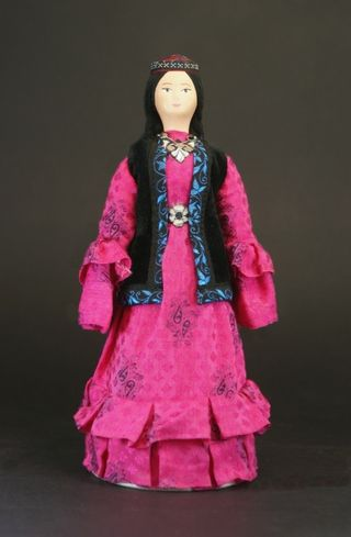 Doll gift porcelain. Kazakh gala maiden costume.
