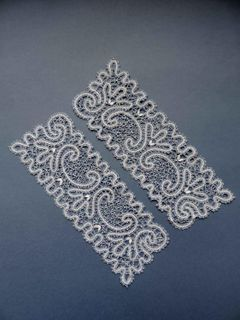 Lace cuffs with a pattern of quatrefoils and scrolls