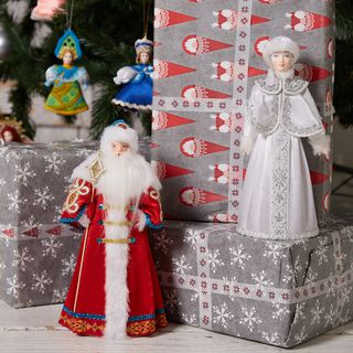 Toys under the tree handcrafted Santa Claus and snow maiden, gift set