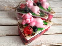 Handmade soap SwinoTort cake in the shape of a cake with a chic pig instead of a cherry