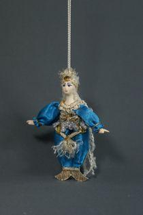 Doll pendant souvenir porcelain. Mermaid. Folk character.