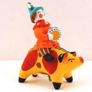 Dymkovskaya earthenware toy buffoon pig on the