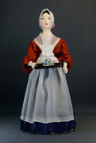 Doll gift porcelain. Costume of a maid. The mid-18th century. France.