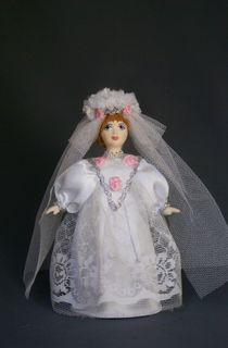 Doll gift porcelain. Girl in a wedding gown.