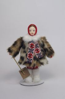 Doll gift porcelain. Girl in winter clothes with a shovel. 20th century. Russia