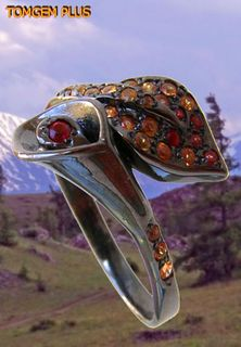 Ring with colored sapphires of silver 925 with black rhodium and gilding