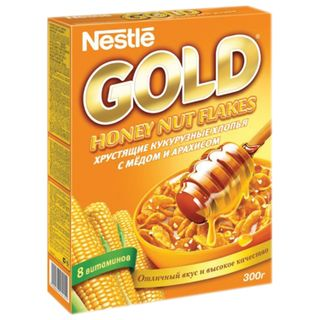 Flakes NESTLE GOLD (Nestle Gold) corn, with honey and peanuts, 300 g, cardboard box