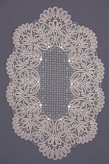 Doily lace oval with ornaments in the form of branches and trilistnika
