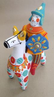 Dymkovo clay toys Bogatyr on the horse