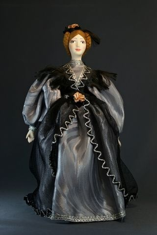 Doll gift porcelain. A lady in a ball gown. First floor. 19th century. Petersburg.