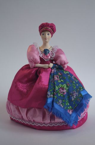 Souvenir doll on the kettle. Merchant with a shawl. Outfit late 19th century - early 20th century Russia