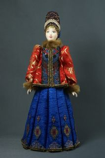 Doll gift porcelain. Kostroma lips. Russia. Women's winter suit. Late 19th - early 20th century.