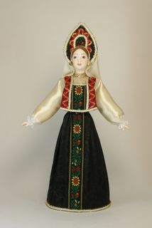 Doll gift porcelain. Kostroma lips. Russia. Women's festive costume. 19th century.