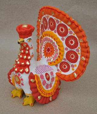 Dymkovo clay toy, the Turkey painted with an orange tail