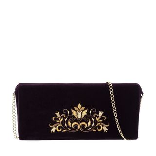 Velvet clutch Compliments the purple color with Golden embroidery