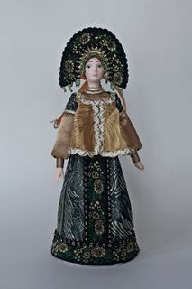 Doll gift porcelain. Girl in festive traditional costume.