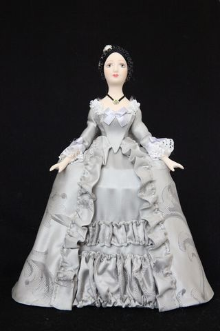 Doll gift porcelain. Women's court costume of the Mid 18th century, Paris.