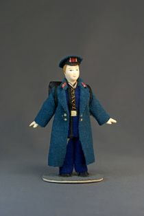 Doll gift. High-school student in uniform with backpack.19th century. Petersburg.