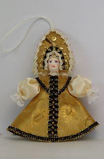 Doll souvenir porcelain. Girl in summer clothes.