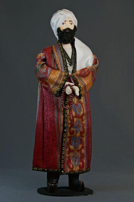 Doll gift porcelain. Traditional Uzbek men's costume.
