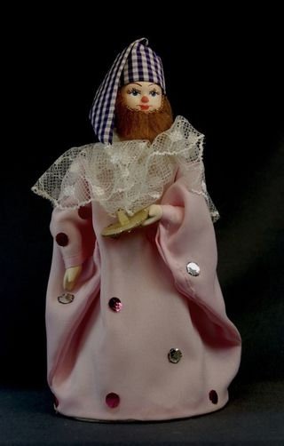 Doll gift porcelain. Gnome with candle. Fairy tale character.
