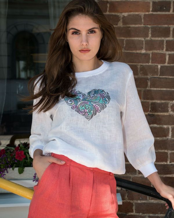 Women's blouse style in white with silk embroidery