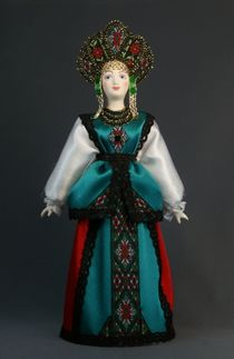 Doll gift porcelain. Novgorod province. Russia. Maiden costume. Late 19th - early 20th century.