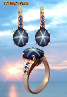 Set: ring and earrings from gold 585 with star sapphire 9,5x10,5 mm and blue sapphires