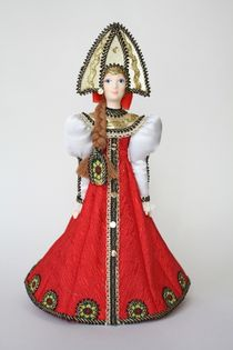 Doll gift porcelain. Girl in traditional festive costume. Late 19th - early 20th century. Russia.
