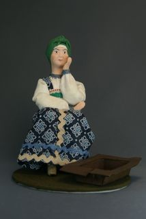 Doll gift porcelain. The old woman at the broken trough. Fairy tale character.