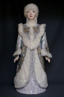 Doll gift porcelain. The snow maiden. Fairy tale character.