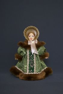 Doll gift porcelain. St. Petersburg young lady in a coat with a Cape and bonnet. 30-40-ies of the 19th century.