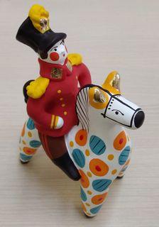 Dymkovskaya earthenware toy Rider on horse in red