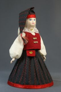 Doll gift porcelain. The Estonian girl's costume with headdress-cap. Late 19th - early 20th century.