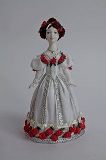 Doll gift porcelain. Girl in ball gown. The middle of the 19th century.
