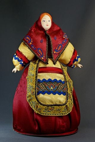 Doll gift porcelain. Matryoshka. The motifs painted wooden toys. Russia.