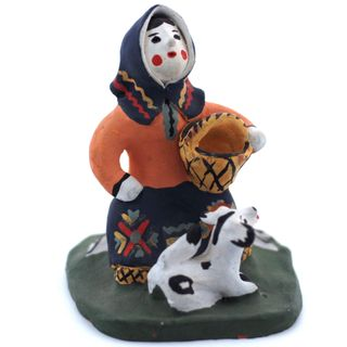 Kargopol clay toy is a Woman on stump