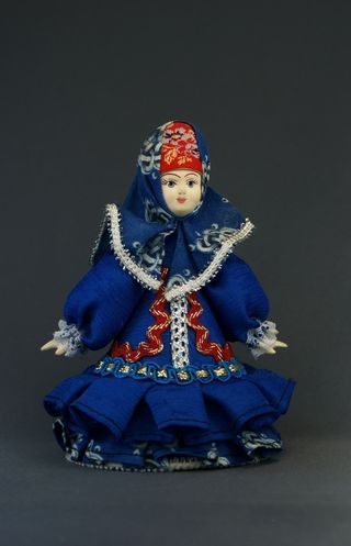 Doll gift porcelain. Traditional Russian costume (style)