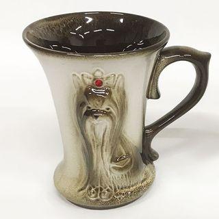 Ceramic mug with a relief image of a cute dog