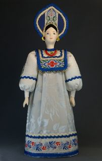 Doll gift porcelain. The North Of Russia. Maiden costume. Late 19th - early 20th century.