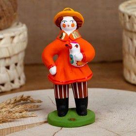 Dymkovskaya earthenware toy Muzhik with a gift