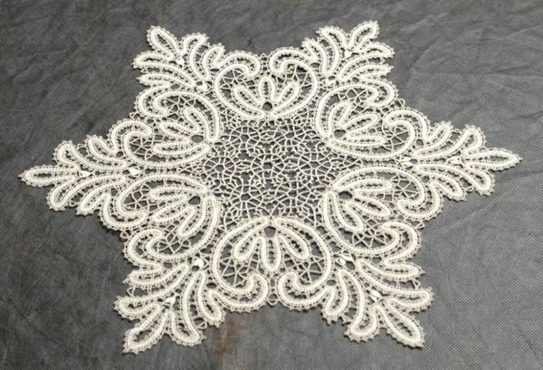 Doily lace round in the form of snowflakes