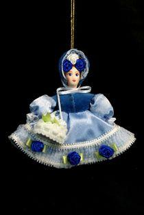 Doll pendant souvenir porcelain. Flower girl.