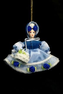Doll pendant souvenir porcelain. Flower girl.