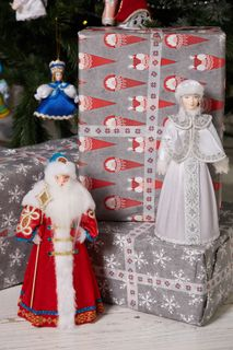 Toy under the Christmas tree, the snow maiden, is handmade from porcelain 26 cm