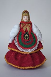Doll gift porcelain. Matreshka-Dunya in traditional summer attire. Russia