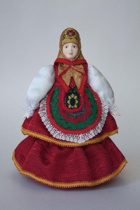 Doll gift porcelain. Matreshka-Dunya in traditional summer attire. Russia